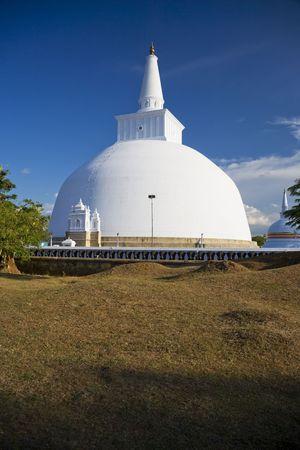 dagoba: Image of UNESCOs World Heritage Site of Ruvanveli Dagoba, located at Anuradhapura, Sri Lanka. Ruvanveli Dagoba is the pride of the Great Emperor Dutugamunu. Raised in the 2nd century B.C. this dagoba is supposed to have the perfect water bubble shape. Stock Photo