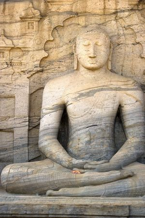 polonnaruwa: Image of a seated Buddha sculpture at Gal Vihara, Polonnaruwa, Sri Lanka. The colossal Buddha image, a masterpiece of Sri Lankan Buddhist art, was carved on the face of a granite boulder, commissioned by Parakramabahu I (1153-1186 AD). This is a UNESCO Wo