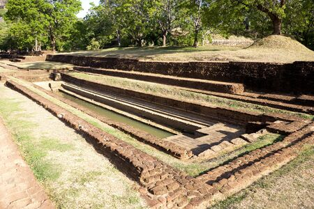 Image of an ancient water garden at UNESCO's World heritage site of Sigiriya (Lion's Rock), Sri Lanka. This is an ancient rock fortress and palace ruin built during the reign of King Kassapa I (477-495 AD). The garden is among the oldest landscaped garden Stock Photo - 5911611