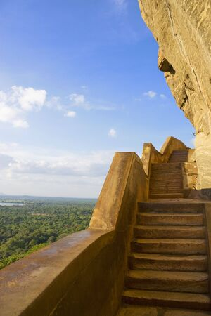 View from Sigiriya (Lions Rock) taken at the steps beside the Mirror Wall. Originally this wall was so well polished that King Kassapa I (477-495 AD), who built the ancient rock fortress and palace, could see himself whilst he walked alongside it. This i photo