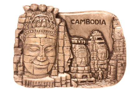 angkor: Isolated macro image of a Cambodian porcelain fridge magnet depicting historical sites and culture of Cambodia.