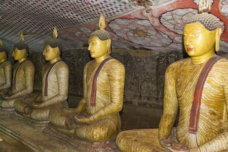 Image of Buddha statues in a cave at the ancient Rock Temple, Dambulla, Sri Lanka. This is a UNESCO World Heritage Site. photo