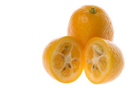 Isolated macro image of fresh kumquats. Stock Photo - 6130148