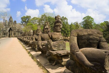 thom: Image of ancient demon statues at the South Gate of UNESCOs World Heritage Site of Angkor Thom, Siem Reap, Cambodia.
