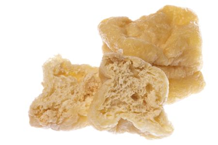 spongy: Isolated image of fried spongy beancurd cubes.