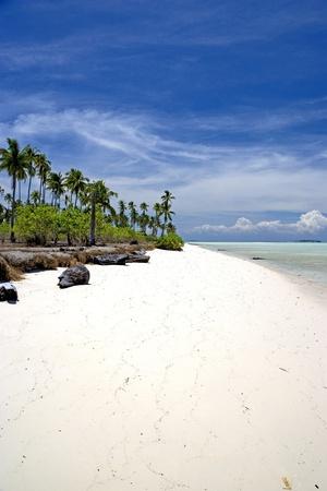Image of a beach on a remote Malaysian tropical island. photo