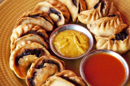 Image of traditional Nepalese fried momos. Stock Photo