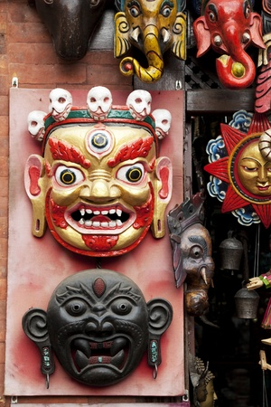 unesco world cultural heritage: Image of wooden masks in traditional Nepalese style for sale at UNESCOs world heritage site of Swayambunath Temple, Kathmandu, Nepal. Stock Photo