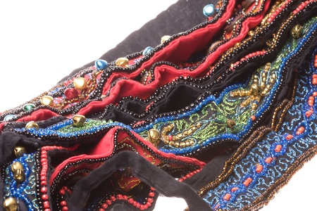 Isolated macro image of traditional Nepalese beaded belts. photo