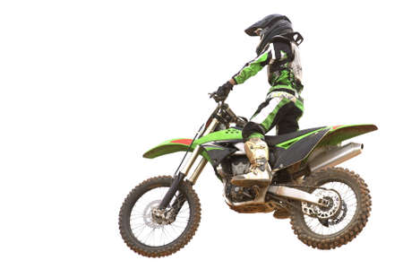 dirt road recreation: Isolated image of a motocross competitor in action. Stock Photo