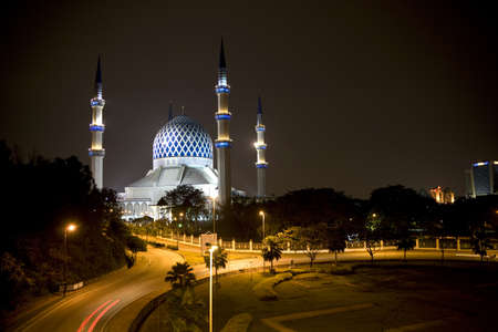 commonly: Night image of Sultan Salahuddin Abdul Aziz Shah Mosque or commonly known as the Blue Mosque, located at Shah Alam, Selangor, Malaysia.  Stock Photo