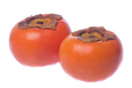 persimmons: Isolated image of fresh persimmons.