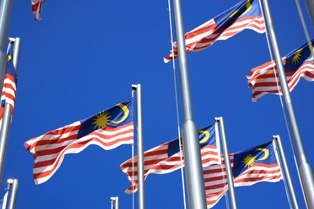 Image of Malaysian flags, also known as Jalur Gemilang, flying high. Stock Photo