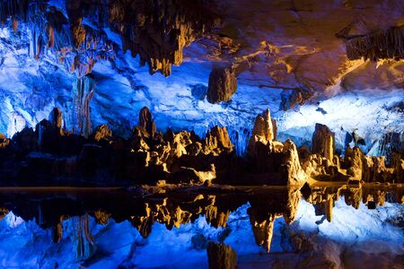 lighted: Image of stalactite and stalagmite formations all lighted up at Reed Flute Cave, Guilin, Guangxi Zhuang Autonomous Region, China. Stock Photo