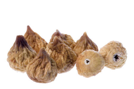 Isolated macro image of dried figs. photo
