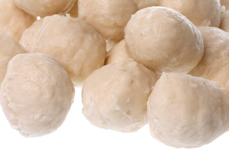 Isolated macro image of chicken balls ready to cook.