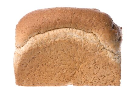 Isolated image of a freshly baked loaf of wheat bran bread. photo
