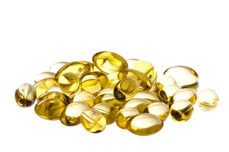 Isolated macro image of cod liver oil capsules.