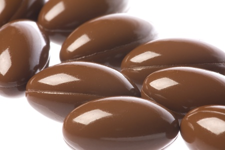 Isolated macro image of CoQ10, also known as Coenzyme Q10 capsules. A health supplement.