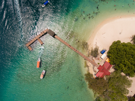 An aerial drone Sapi Island,Sabah,Malaysia.Sapi island literally known as Cow Island in Malay is just off the south-western tip of Gaya Island.