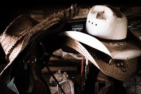 barns winter: Worn cowboy hats in a barn