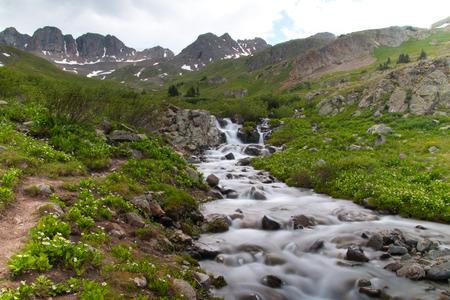 soft peak: hiking trail along a mountain stream