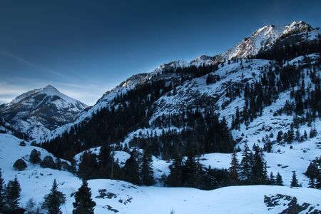 snow capped mountain: Snow capped mountain winter scene at sunrise
