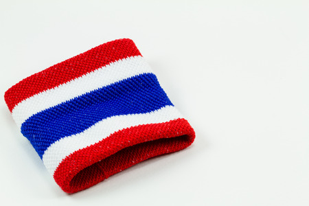 Red white blue cloth wristband isolated on white background