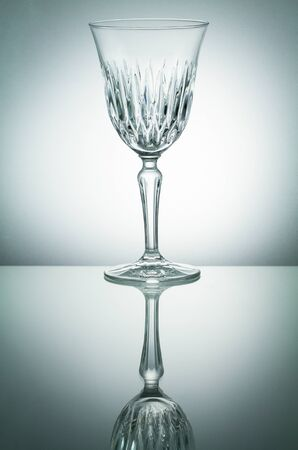 glass reflection: Crystal  glass with reflection on white illuminated background Stock Photo