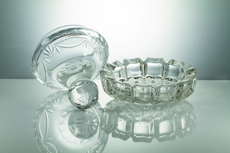 crystal bowl: Crystal bowl with reflection on illuminated white background