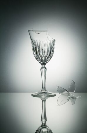 glass reflection: Broken crystal  glass with reflection on white illuminated background Stock Photo