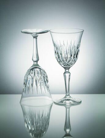 illuminated: Crystal  glasses with reflection on white illuminated background