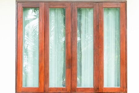 glass windows: Glass windows with wooden frame on white wall