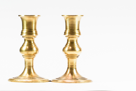 Vintage brass candle stick on white background