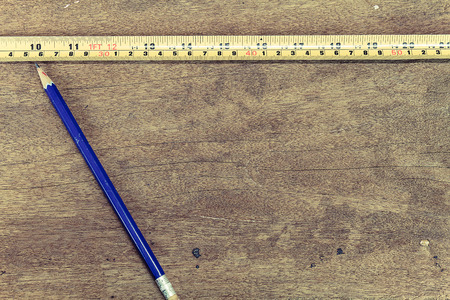 cintas metricas: Measuring tape, pencil  on vintage wooden background in vintage style
