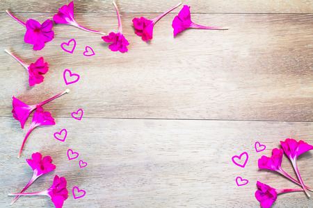 Hearts and flowers stock photos royalty free hearts and flowers images pink flowers formed as border with hearts on wooden background mightylinksfo