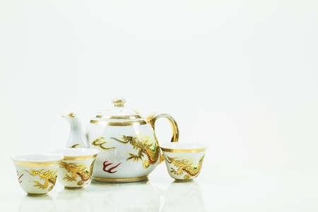 chinese teapot: Vintage grunge chinese teapot set with golden dragons on white background Stock Photo