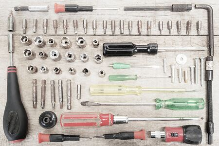 Old grunge screw drivers set on wooden background Stock Photo