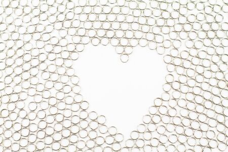 heart shaped: Heart shaped metal rings texture isolated on white background Stock Photo