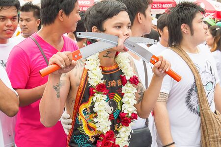 body piercing: Phuket, Thailand - Oct 18, 2015 : Unidentified participant performing body piercing,  Phuket vegetarian festival. It is annually event.