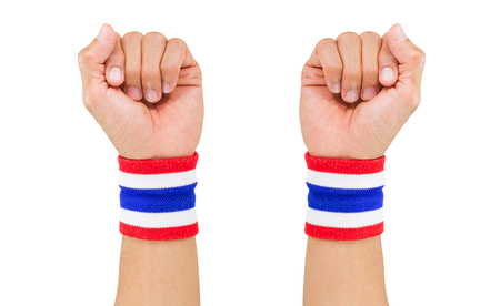 elasticity: Two Thai national color cloth wristbands on the guys wrists on white background