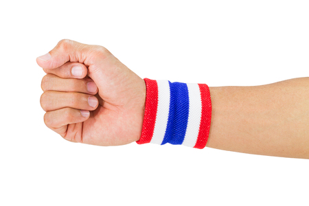 elasticity: Thai national color cloth wristband on the guys wrist on white background