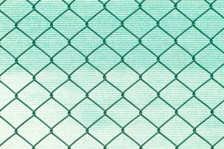 nylon: Grid metal wires on blurred green nylon background