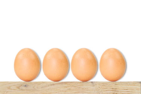 lesion: Fresh eggs with soft shadow on wooden vintage floor on white background