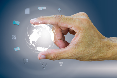 man's thumb: Mans forefinger and thumb holding globe with worldwide connection, digital communication technology concept