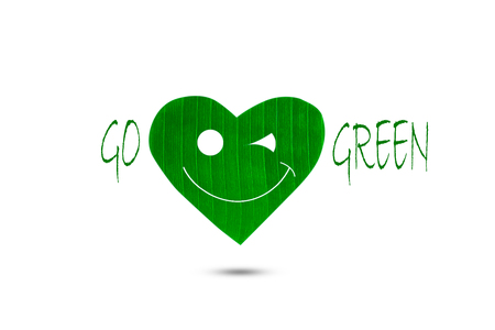 heart shaped: Smiling heart shaped green leaf with text go green on white background, environment concept Stock Photo