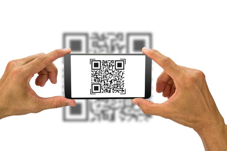 Mans hands holding smartphone scanning QR code on white background, business concept