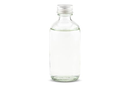 Cold pressed coconut oil in bottle on white background Stock fotó