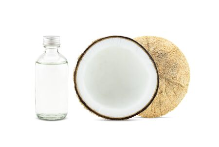 Cold pressed coconut oil in bottle with fresh coconuts on white background Stock fotó