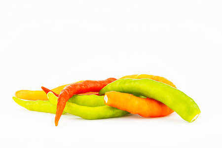 Pile of orange,yellow and green chilli isolated on white background Stock fotó - 151367093